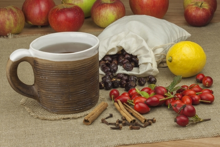 proven: A flu epidemic. Traditional home treatment for colds and flu. Rosehip tea, honey and citrus. Hot tea with honey and lemon on a tabletop. Home Pharmacy. Proven treatment of diseases.