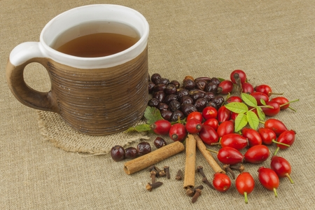 colds: A flu epidemic. Traditional home treatment for colds and flu. Rosehip tea, honey and citrus. Hot tea with honey and lemon on a tabletop. Home Pharmacy. Proven treatment of diseases.