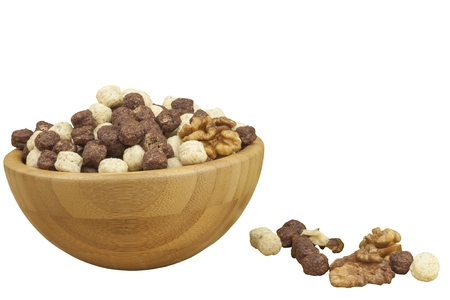 chocolate cereal: Chocolate cereal balls in a bowl of bamboo. Healthy breakfast with fruit and milk. A diet full of energy and fiber for athletes. Quick to prepare homemade breakfast. Isolated on white