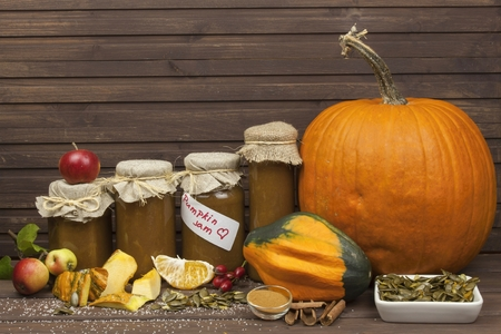 domestic production: Domestic production pumpkin marmalade. Sweet childrens menu. Preserving domestic products. Processing pumpkins, autumn harvest time. Pumpkin jam in glass jar with ingredients.