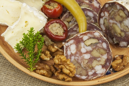 refreshments: Delicious specialty food, salami with walnuts. Refreshments for important guests. Traditional specialty food. Preparation of home entertainment.