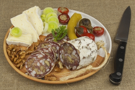 home entertainment: Delicious specialty food, salami with walnuts. Refreshments for important guests. Traditional specialty food. Preparation of home entertainment.