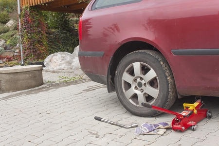 replace: Remove, Install, replace Wheel tire nut for car  vehicle service concep. Replacing summer tires for winter tires.