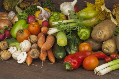 Various types of vegetables on an old wooden table. The concept of diet food. Food for obese patients. Autumn harvest vegetables. Growing fresh home-grown vegetables. Stock Photo