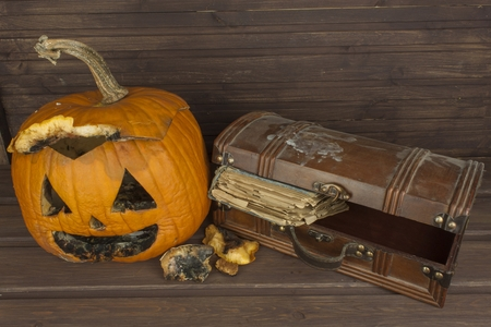 remembering: End of Halloween, Moldy pumpkin. Remembering Halloween. Head carved from a pumpkin on Halloween. Pumpkin tradition. Place for your text. Invitation for halloween. Scary Halloween pumpkin