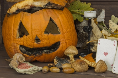discontinued: Old Moldy pumpkin. Remembering Halloween celebration. Rot on the pumpkin. Halloween scary garden decoration. Discontinued party. Stock Photo