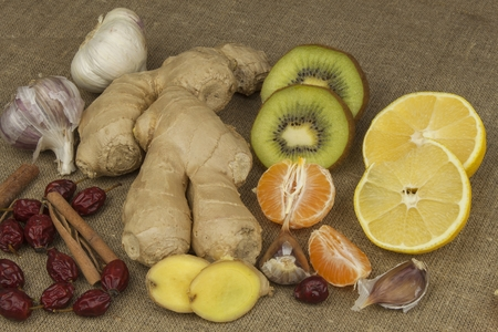 colds: Traditional homemade medicine. Alternative Treatment. Home treatment for colds and flu. Rosehip, garlic, ginger and citrus. Home Pharmacy. Recipe for Health. Stock Photo