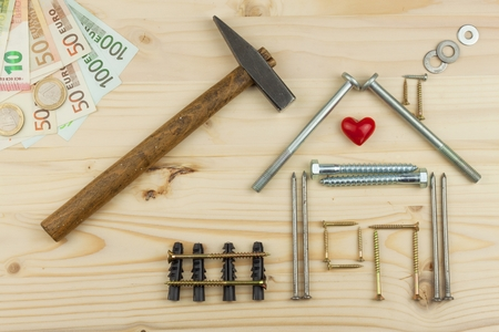 hypothec: Mortgage to build a house for the family. Real money to build a house. The loan money for housing. Construction of a new house. Plans for the building. Needs for builders. Stock Photo