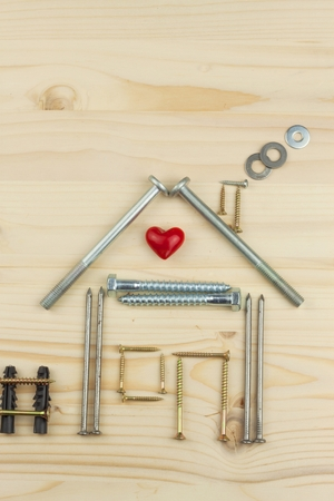 Mortgage to build a house for the family. Real money to build a house. The loan money for housing. Construction of a new house. Plans for the building. Needs for builders. Stock Photo