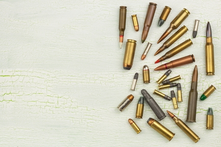 Sales of weapons and ammunition. Trade in arms and ammunition. Different types of ammunition. Bullets of different calibers and types. The right to own a gun 版權商用圖片