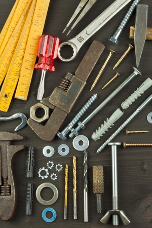 hypothec: Building a house for the family. Needed for building. Building components. Screws and tools for building. Planning for the construction of the house. Model House of components. Stock Photo