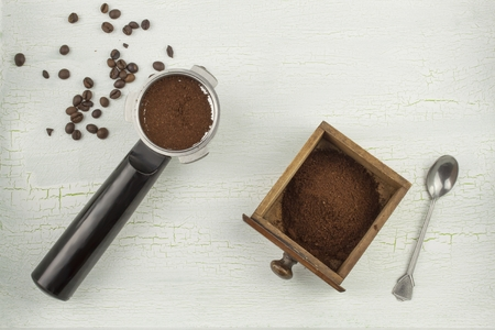 shadowed: A cup of hot coffee on shadowed, cracked background. Morning coffee strong. Stock Photo