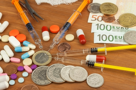 cancer drugs: Money for expensive treatment. The Swiss franc and the euro on drugs. Selling drugs. Expensive health care. Modern medicine. Cancer Treatment. Stock Photo