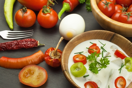 Fresh vegetables for snacks with dressing. Dip for vegetables. Healthy diet meal for dinner. Preparing vegetables in a home kitchen. Stock Photo