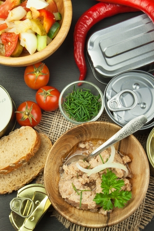 tinned: Crushed canned tuna. The fishing industry, canned fish. Diet food. Tinned tuna. Bowl with canned Tuna. Domestic food preparation.