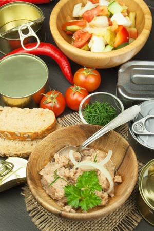 crushed cans: Crushed canned tuna. The fishing industry, canned fish. Diet food. Tinned tuna. Bowl with canned Tuna. Domestic food preparation.