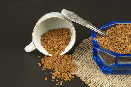soluble: Instant coffee in a glass dish. Preparation of soluble coffee. Decorate store coffee. Stock Photo