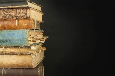 antique books: Stack of old books, copyspace for your text. Antique books on old wooden shelf. Stock Photo