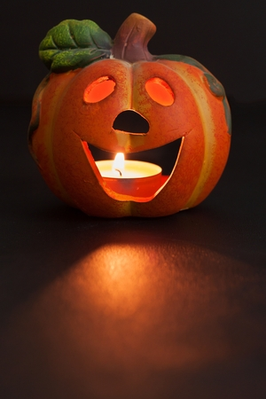 terrifying: Pumpkin lantern for Halloween. Haunted greeting. Traditional spooky decorations.