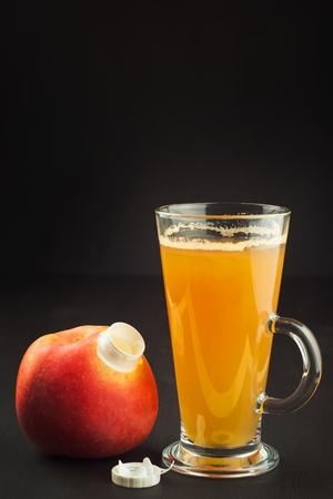 Healthy fresh apple juice drink on wooden background. Domestic production of apple juice for breakfast.