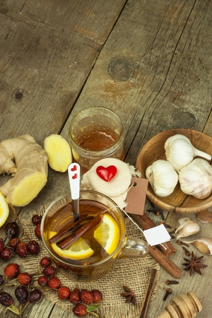 colds: Natural treatment for colds and flu. Ginger lemon honey garlic and rosehip tea against influenza. Hot tea for colds. Home Pharmacy. Proven treatment of diseases. Folk medicine.