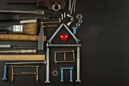 hypothec: Plans for family living. Building a house for the family. Needed for building. Building components. Screws and tools for building. Planning for the construction of the house. Stock Photo