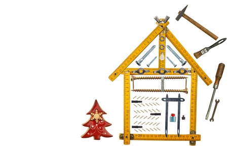 hypothec: Christmas in a newly built house. Gift on Christmas Eve. Mortgage to build a house. The construction of the building. Isolated on white. Stock Photo
