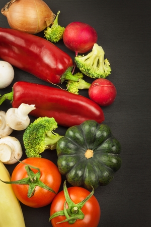 Freshly harvested organic vegetables on a wooden table. Vegetables on vintage wood background - autumn harvest. Rural still life from above with free text space.
