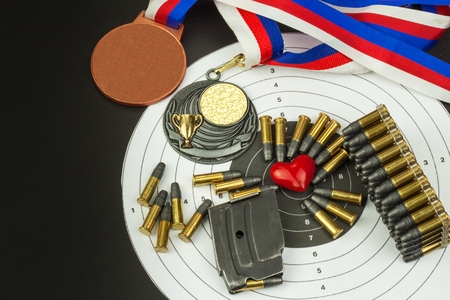 Concept of shooting Competitions. Sport shooting. Biathlon background diploma. Tools and targets on wooden background. Caliber 22