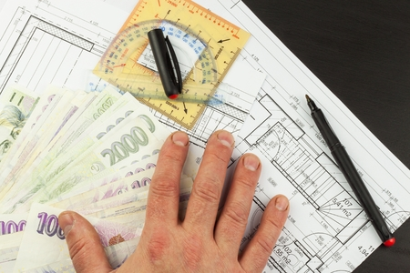 Money to build a house. Mortgage installment. Valid Czech banknotes. Part of architectural project, architectural plan, technical project, construction plan.