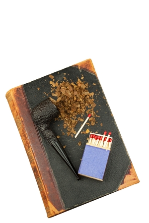 entheogen: Smoking pipe and antique books. Tobacco pipe on ancient books. Relax by reading old books. Tuxedo. Risk of Cancer. Isolated on white.