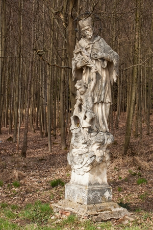Baroque statue of the saint in the forest near the town of Trebic in the Czech Republic Stock Photo