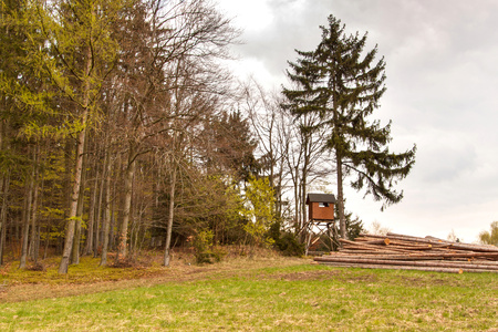 Hunting hide in the forest. Hunting stash. The wooden tower Stock Photo