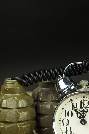 Grenade and old alarm clock. Timed bomb. The concept of terrorism Stock Photo