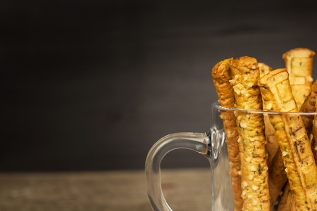 caloric: Salt sticks in a glass. Snack party. Unhealthy pastry for beer