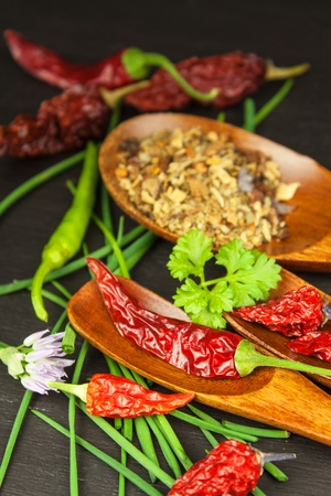 Dried chili on a wooden spoon. Sale of spices. Cultivation of peppers Stock Photo