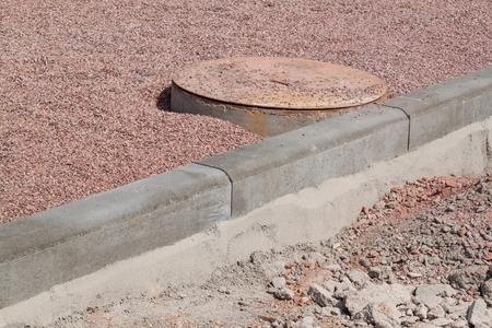 Concrete curb on new building site. Roadwork Standard-Bild