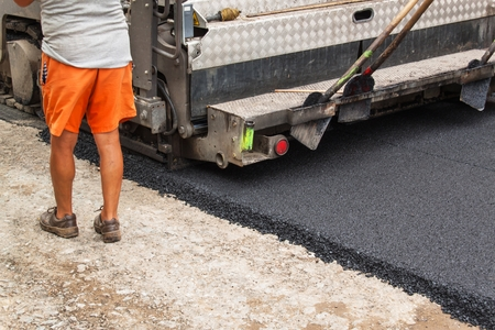 asphalting: New asphalt road. Road asphalt works.  Construction works