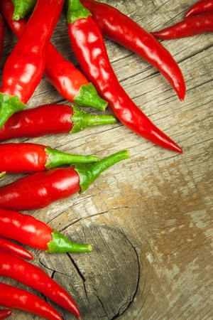 spice: Fresh chili pepper on a wooden board. Growing chili. Healthy spice Stock Photo