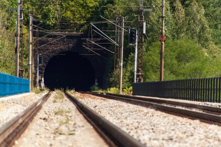 Entrance to the tunnel on the railway bridge. Traveling by train across Europe Stock Photo