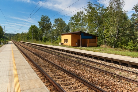 An abandoned rural railway station in the Czech Republic. Empty platform at the station. Traveling by train across Europe