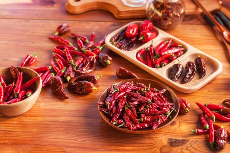 Harvesting chilli peppers. Preparing for drying spicy seasoning. Sale of spices