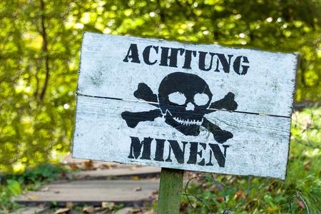 Warning of mines. Danger of explosion.  Line of defense. Military base. German inscription: Zdjęcie Seryjne