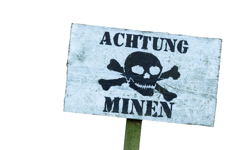 Warning of mines isolated on white.  Line of defense. Military base. German inscription: