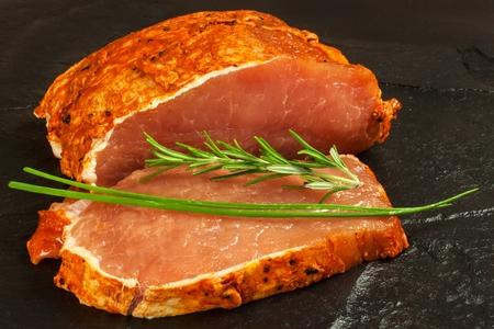 Marinated pork chop. Fresh sliced ??pork. Sale of meat. Preparation for grilling Stock Photo