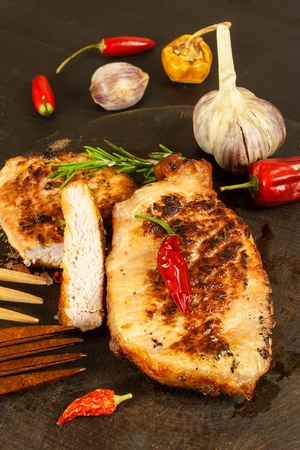 Pork chop for frying. Fresh meat on grill. Diet food. Kitchen utensils