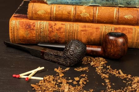 Tobacco and old books. Reading and detective novel