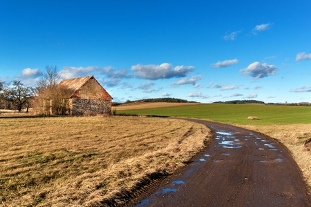 The muddy road in the countryside. Landscape of the Czech countryside. A sunny day on a farm Reklamní fotografie