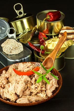 Crushed tuna canned. Sales of fish products. Healthy food with omega 3. Industrial fishing