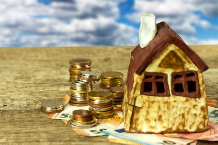 Model of a family house. Concept of mortgage. Sale of houses